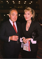 LORD PALUMBO and MRS DONATELLA FLICK, at a reception in London on 2nd June 1998.MIA 16