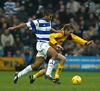 Photo. Chris Ratcliffe<br /> QPR v Rushden & Diamonds. Nationwide Division 2. 03/01/2004<br /> Andy Burgess of Rushden goes down under a challenge from Clarke Carlisle of QPR