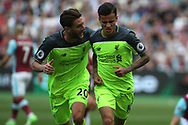 Philippe Coutinho of Liverpool (R) celebrates after scoring his teams second goal. Premier league match, West Ham Utd v Liverpool at the London Stadium, Queen Elizabeth Olympic Park in London on Sunday 14th May 2017.<br /> pic by Steffan Bowen, Andrew Orchard sports photography.