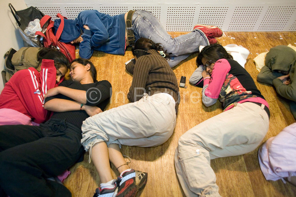 Dancers in the chorus line sleep between rehearsals for the Merchants of Bollywood in the Yash Raj Studios in Mumbai (Bombay), India<br /> <br /> The Merchants of Bollywood, An Indian theatrical dance musical, charts the history of the world's largest and most prolific film industry, and is loosely based on the showbusiness, Merchant family. Seen by over two million people worldwide, the show is homage to the world of Indian cinema.