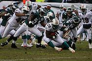 PHILADELPHIA - NOVEMBER 18: The Philadelphia Eagles defense tries to take down Jesse Chatham #28 of the Miami Dolphins during the game on November 18, 2007 at Lincoln Financial Field in Philadelphia, Pennsylvania.