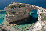The Trypitos Arch, a limestone rock formation over the sea on the coast of Paxos, The Ionian Islands, Greece, Europe