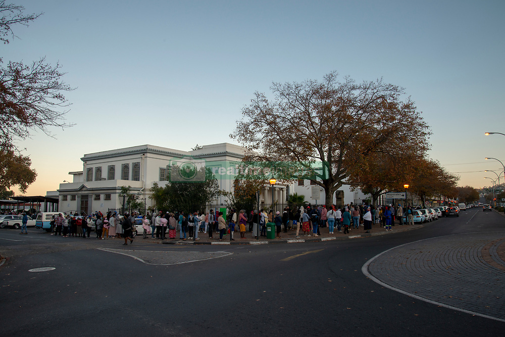 People queing outside the Department of Labour before it opens this morning, in Somerset West, Western Cape, on May 11, 2020. One of the two lines, starting around the corner, goes to the Department of Home Affairs, also located on Main Street. The South African government, which was initally lauded for it's quick response to COVID-19 is facing increased criticism for the prolonged lockdown, during which most people have lost business and income, and others are starving. Here people are queing to apply for unemployment benefits and social grants. PHOTO: EVA-LOTTA JANSSON