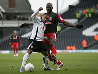 Photo: Lee Earle.<br /> Fulham v Stoke City. The FA Cup. 27/01/2007.Fulham's Wayne Routledge (L) holds off Mamady Sidibe.