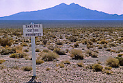 Sign in Nevada desert. Whoever put up the sign got there too late.