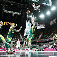 02 August 2012: France Mickael Gelabale goes for the jumpshot over Lithuania Simas Jasaitis during 82-74 Team France victory over Team Lithuania, during the men's basketball preliminary, at the Basketball Arena, in London, Great Britain.