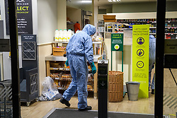 © Licensed to London News Pictures. 26/08/2021. London, UK. Forensic investigators at a Little Waitrose store on Fulham Palace Road following the arrest of a man on suspicion of contamination of goods with intention of causing public harm or anxiety after foodstuffs at supermarkets were injected with needles. Metropolitan Police were called at approximately 19:40BST on Wednesday 25/08/2021 after a man was reported to be shouting abuse at people in the street. The man is reported to have gone into three supermarkets in Fulham Palace Road and injected foodstuffs with a number of needles. Photo credit: Peter Manning/LNP