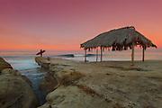 Surfer at Sunrise on the California Coast