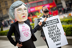 © Licensed to London News Pictures. 29/03/2017. London, UK. Avaaz hold a demonstration against the triggering of Article 50 by holding a stunt on Parliament Square with a costumed Theresa May. Photo credit : Tom Nicholson/LNP