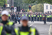 British police officers in riot gear secure the area around The Cenotaph war memorial, facing far-right demonstrators protesting against an expected Black Lives Matter demonstration, on Whitehall in central London, Saturday, June 13, 2020. (Photo/ Vudi Xhymshiti)