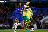Willian of Chelsea (L) battles with Mario Vrancic of Norwich City (R). The Emirates FA Cup, 3rd round replay match, Chelsea v Norwich City at Stamford Bridge in London on Wednesday 17th January 2018.<br /> pic by Steffan Bowen, Andrew Orchard sports photography.