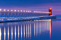 The freshly thawed Black River with its glass-like surface reflects the bright light of South Haven's pier and lighthouse.