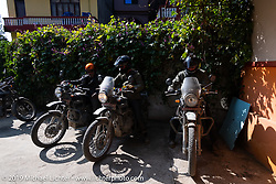 Cool Beans Chris Marino, Devil Chicken artist Chris Galley and Biltwell photographer Geoff Kowalchuk leaving the Hotel Benju in Kushma after a lunch stop on Motorcycle Sherpa's Ride to the Heavens motorcycle adventure in the Himalayas of Nepal. On the sixth day of riding, we went from Tatopani to Pokhara. Saturday, November 9, 2019. Photography ©2019 Michael Lichter.