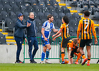 Bristol Rovers' Luke Leahy and Hull City's George Honeyman clash after a challenge on Hull City's Callum Elder with Bristol Rovers manager Joey Barton and coach Clint Hill close by<br /> <br /> Photographer Lee Parker/CameraSport<br /> <br /> The EFL Sky Bet League One - Hull City v Bristol Rovers - Saturday 6th March 2021 - KCOM Stadium - Kingston upon Hull<br /> <br /> World Copyright © 2021 CameraSport. All rights reserved. 43 Linden Ave. Countesthorpe. Leicester. England. LE8 5PG - Tel: +44 (0) 116 277 4147 - admin@camerasport.com - www.camerasport.com