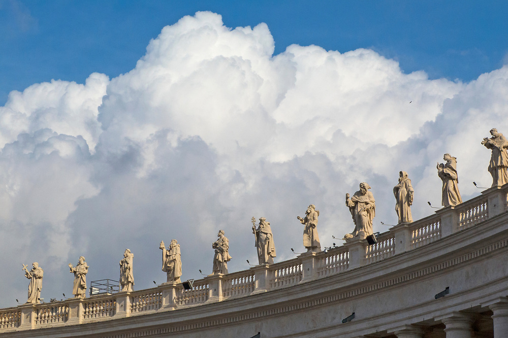 Saint statues on Saint Peter's Basilica roof edge facing the square