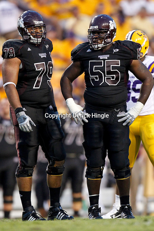Sep 18, 2010; Baton Rouge, LA, USA; Mississippi State Bulldogs offensive linesman Derek Sherrod (79) and offensive linesman Quinten Saulsberry (55) during the first half against the LSU Tigers at Tiger Stadium.  Mandatory Credit: Derick E. Hingle