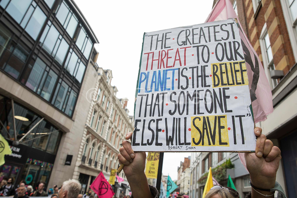 Environmental activists from Extinction Rebellion take part in the first day of Impossible Rebellion protests in the Covent Garden area on 23rd August 2021 in London, United Kingdom. Extinction Rebellion are calling on the UK government to cease all new fossil fuel investment with immediate effect.