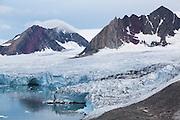 Dramatically eroded nunataks rise above the calving terminus of Samarinbreen, a tidewater glacier in Hornsund, Svalbard.