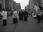Episcopal Ordination Of Desmond Connell. (R74).1988..06.03.1988..03.06.1988..6th March 1988..Following the death of Archbishop Kevin McNamara in April '87, Pope John Paul II surprisingly nominated Desmond Connell for the position of Archbishop of Dublin. The ordination of Dr Connell took place at the Pro-Cathedral in Dublin...Picture shows the procession down Marlborough Street, Dublin a prelude to the Episcopal Ordination of Dr Desmond Connell.Girl guides and scouts formed the guard of honour. Members of the other religions within the state also attended the ordination.