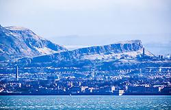 Salisbury Crags, Edinburgh as seen from the A921 near Burntisland, Fife.