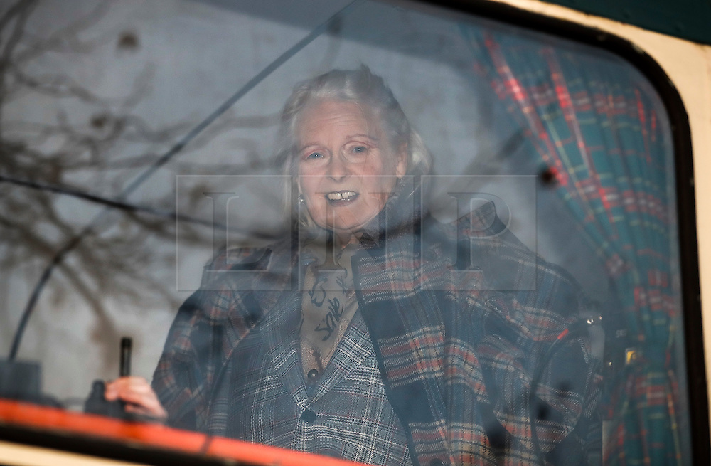 """© Licensed to London News Pictures. 26/11/2016. London, UK. DAME VIVIENNE WESTWOOD watches from a bus. Joe Corre, the son of former Sex Pistol manager Malcolm McLaren and Vivienne Westwood burns his personal collection of Sex Pistols punk memorabilia. Earlier this week Joe Corre said that punk has become nothing more than a """"McDonald's brand ... owned by the state, establishment and corporations"""". His collection is estimated to be worth £5 million. Photo credit: Peter Macdiarmid/LNP"""