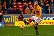 Liam Grimshaw of Motherwell plays the ball down the line  during the Ladbrokes Scottish Premiership match between Motherwell and Heart of Midlothian at Fir Park, Motherwell, Scotland on 17 February 2019.