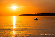 Kayaking at sunset in the Apostle Islands National Lakeshore of Lake Superior near Bayfield, Wisconsin, USA model released