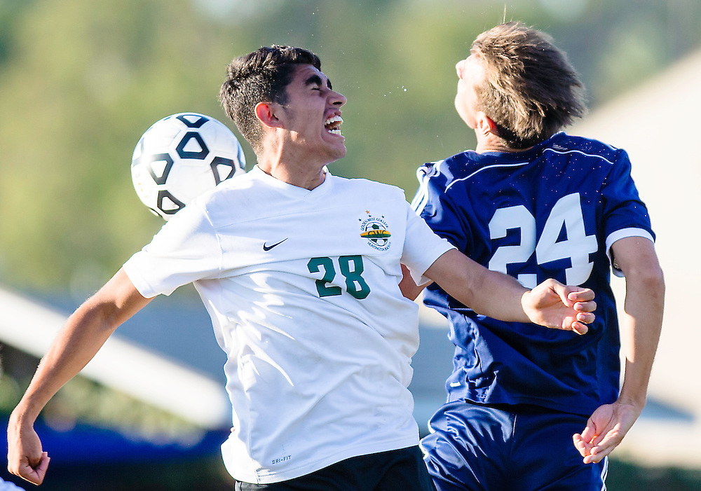Brian Montano of Golden West and Wade  Hoban of Fullerton College go up and fight for a ball during the 2nd half of Golden Wests 2-0 win on November 4, 2016.