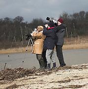 A group of four birdwatchers at Benacre Broad, Suffolk, England
