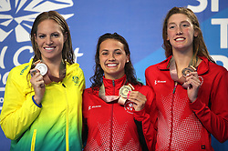 Australia's Emily Seebohm (silver), Canada's Kylie Masse (gold) and Taylor Ruck (bronze) with their medals after the Women's 100m Backstroke Final at the Gold Coast Aquatic Centre during day three of the 2018 Commonwealth Games in the Gold Coast, Australia. PRESS ASSOCIATION Photo. Picture date: Saturday April 7, 2018. See PA story COMMONWEALTH Swimming. Photo credit should read: Danny Lawson/PA Wire. RESTRICTIONS: Editorial use only. No commercial use. No video emulation.