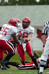 08 Oct 2005  Hilltoppers Quarterback Justin Haddix hands off to his running back Lerron Moore. The Illinois State University Redbirds roped and tied the Western Kentucky University Hilltoppers in regulation but loosened the noose in Overtime as the Hilltoppers take the honors with a 37 - 24 Victory in Gateway Conference action at Hancock Stadium on Illinois State's campus in Normal IL.