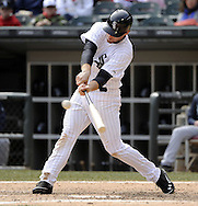 CHICAGO - APRIL 06:  Conor Gillaspie #12 of the Chicago White Sox hits a single against the Seattle Mariners  on April 06, 2013 at U.S. Cellular Field in Chicago, Illinois.  The White Sox defeated the Mariners 4-3.  (Photo by Ron Vesely)   Subject:  Conor Gillaspie