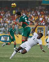 Photo: Steve Bond/Richard Lane Photography.<br />Ghana v Morocco. Africa Cup of Nations. 28/01/2008. Elamin erbate (L) clears as Asamoah Gyan (R) goes over