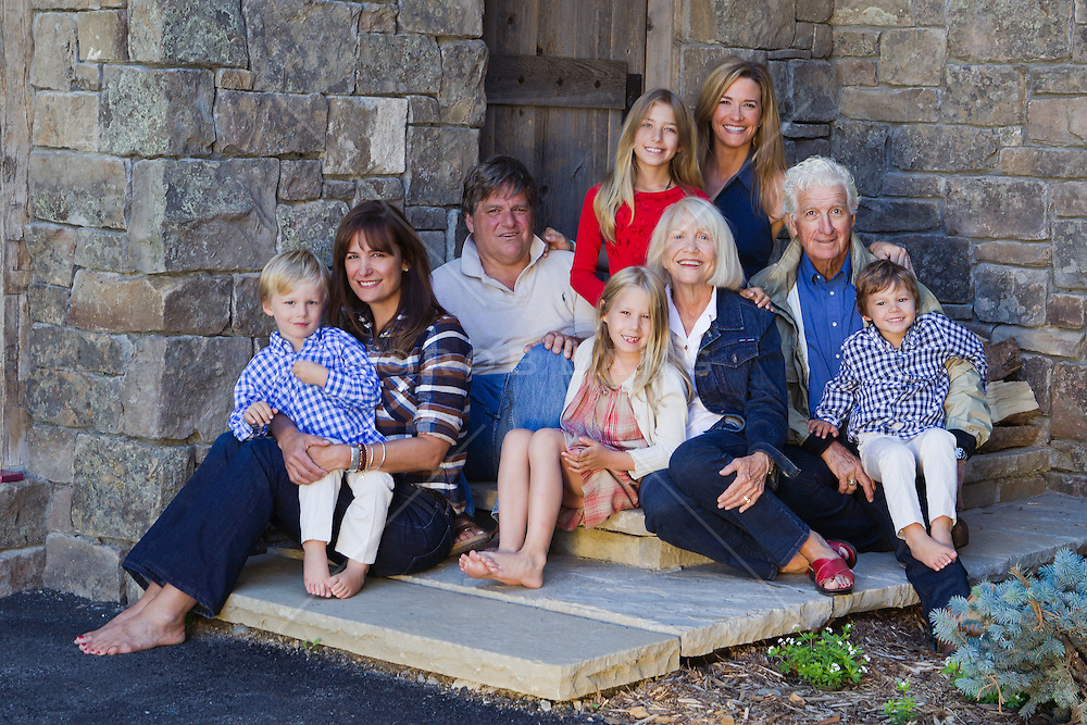 family gathered together with grandparents for a group photograph