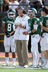 19 September 2015:  Jack Warner speaks with head coach Norm Eash during an NCAA division 3 football game between the Simpson College Storm and the Illinois Wesleyan Titans in Tucci Stadium on Wilder Field, Bloomington IL