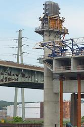 Cast-in-place Hollow Box Girder Operations and Tower, New Pearl Harbor Memorial Bridge under Construction at New Haven Harbor Crossing, Connectictut. CONNDOT Contract B, Project #92-618. When complete the alternately named Quinnipiac River Bridge will be first Extradosed Engineered & Designed Bridge in the United States.