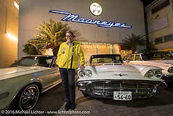 Shige Suganuma with some of his cars in front of his offices during the Monday night afterparty at Mooneyes Area One after the Mooneyes Yokohama Hot Rod & Custom Show. Yokohama, Japan. December 5, 2016.  Photography ©2016 Michael Lichter.