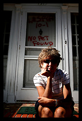 May 20th, 2006. Louisiana. Missing New Orleans.  Barbara Spangenberg returns to her once beloved Broadmoor neighbourhood which was devastated by Hurricane Katrina floodwaters. Graffiti from animal rescuers still glows from doorways. Barbara and her husband Rob, a 4th generation New Orleans resident have sold up after living in and raising a family on S. Prieur Street for 25 years. They now live in Houston. Barabara lost her job, her home and many memories to Katrina. Her husband's job relocated to Houston where she is now studying at nursing school.