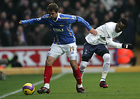 Photo: Lee Earle/Sportsbeat Images.<br /> Portsmouth v Tottenham Hotspur. The FA Barclays Premiership. 15/12/2007. Portsmouth's Niko Kranjcar (L) battles with Pascal Chimbonda.