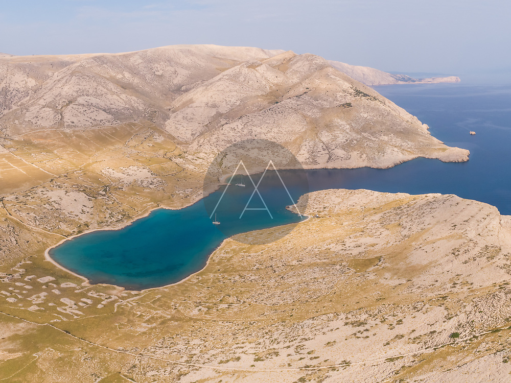 Aerial view of the Mala Luka beach on the shore of the bay in Baska, Krk island, Croatia.