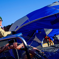 120613       Cable Hoover<br /> <br /> Sharna Sutherin and other crew members try to inflate their balloon during the Red Rock Balloon Rally at Red Rock Park in Gallup Friday.