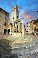 Medieval buildings of Piazza della Cisterna, San Gimignano, Tuscany Italy .<br /> <br /> Visit our ITALY PHOTO COLLECTION for more   photos of Italy to download or buy as prints https://funkystock.photoshelter.com/gallery-collection/2b-Pictures-Images-of-Italy-Photos-of-Italian-Historic-Landmark-Sites/C0000qxA2zGFjd_k<br /> If you prefer to buy from our ALAMY PHOTO LIBRARY  Collection visit : https://www.alamy.com/portfolio/paul-williams-funkystock/sangimignano.html