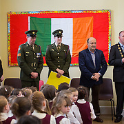 23/10/2015              <br /> Members of the Defence Forces were in Abbeyfeale today to present a handmade Tricolour and a copy of the Proclamation of the Irish Republic to students of the town's two primary schools.<br /> <br /> St Marys Boys National School and Scoil Mháthair Dé are among 3,000 schools nationally and 152 Limerick primary schools to receive the presentation as part of initiatives to mark the centenary of the 1916 Rising.<br /> <br /> Councillor Liam Galvin, Mayor of the City and County of Limerick joined pupils and teachers for today's presentation ceremony, which saw representatives of the Defences Forces raise the flag and read the Proclamation. <br /> <br /> Attending the ceremony at Scoil Mháthair Dé were, Damian Brady, Limerick City and County Co-Ordinator 2016, Sergeant James Reddan, Private Ciara Quinn, James Joy, Chairman of the Board Scoil Mháthair Dé, and Mayor of Limerick Cllr. Liam Galvin.<br /> <br />   Picture: Alan Place.