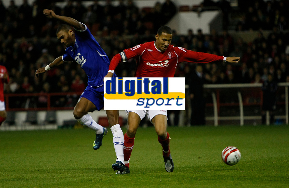 Photo: Richard Lane/Richard Lane Photography. Nottingham Forest v Birmingham City. Coca Cola Championship. 08/11/2008. Marcus Bent (L) is muscled out by Kelvin Wilson (R)