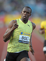 Usain Bolt powers to a win in the mens 100m final with a time of 9.92<br /> Aviva London Grand Prix<br /> Crystal Palace National Sports Centre, London, UK<br /> 24/07/2009. Credit Colorsport/Dan Rowley