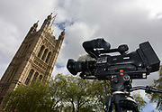 A TV video camera ready to report the 2015 general election, located under Victoria Tower at the Palace of Westminster in central London. Days before the general election of 2015, an eventual victory for David Cameron's Conservatives, we see the broadcast equipment ready to film and report the goings on at Westminster, a symbol for government and parliamentary activity.  After the result, the Conservatives once again accused the BBC of bias throughout the election campaign.