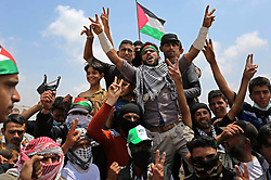 April 27, 2018 - Khan Younis, Gaza Strip - Palestinian protesters shout slogans during clashes with Israeli security forces in tents protest demanding the right to return to their homeland, at the Israel-Gaza border, in Khan Younis in the southern Gaza. (Credit Image: © Ashraf Amra/APA Images via ZUMA Wire)