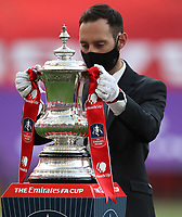 Football - 2020 Emirates 'Heads Up' FA Cup Final - Arsenal vs. Chelsea <br /> <br /> A man with a face-mask places the trophy on a pedestal prior to the presentation, at Wembley Stadium.<br /> <br /> The match is being played behind closed doors because of the current COVID-19 Coronavirus pandemic, and government social distancing/lockdown restrictions.