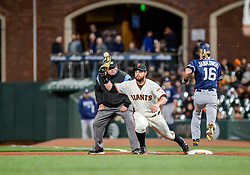 April 30, 2018 - San Francisco, CA, U.S. - SAN FRANCISCO, CA - APRIL 30: San Diego Padres Outfield Travis Jankowski (16) safe at first after the ball hits the top of San Francisco Giants First baseman Brandon Belt's (9) glove during the San Francisco Giants and San Diego Padres game on April 30, 2018 at AT&T Park in San Francisco, CA. (Photo by Stephen Hopson/Icon Sportswire) (Credit Image: © Stephen Hopson/Icon SMI via ZUMA Press)
