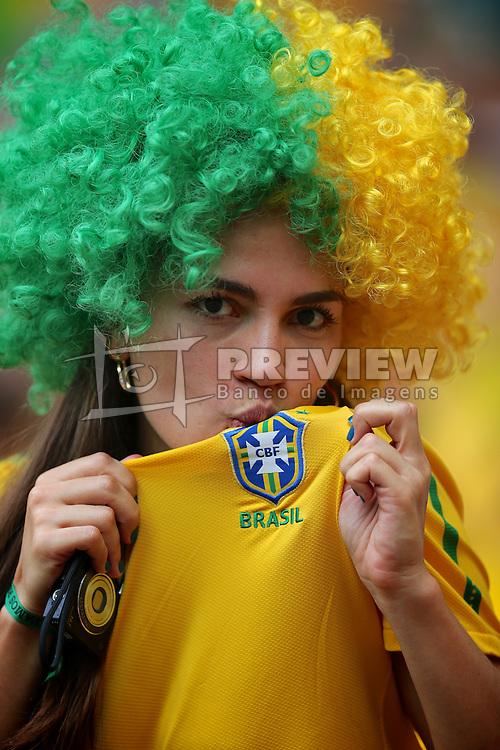 Torcedora do Brasil durante a cerimônia de abertura da Copa das Confederações, realizada no Estádio Nacional Mané Garrincha, em Brasília, antes da partida entre Brasil e Japão. FOTO: Jefferson Bernardes/Preview.com